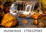 River creek waterfall rocks view. Waterfall rocks in creek water. Creek water waterfall rocks. Waterfall rocks view