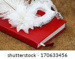 White Mask  On Red Book