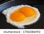 Cooking An Egg With Two Yolks ...