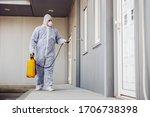 Man In Virus Protective Suit...