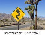 Yellow Winding Road Sign In...