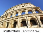 Part Of Colosseum At Blue Sky...