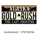 An imitation Alaska license plate with text Gold Rush written on it making a great concept. Words on the bottom The Last Frontier