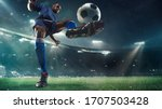 Small photo of Professional football or soccer player in action on stadium with flashlights, kicking ball for winning goal, wide angle. Concept of sport, competition, motion, overcoming. Field presence effect.