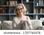 Elderly Woman In Glasses Sit On ...