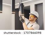 Electrician Installs Lamp...