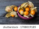 Physalis In A Bowl On A Wooden...