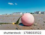 A Faded Pink Fishermans Buoy ...