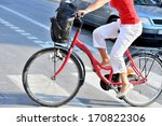 Cyclist in profile, sunny day - stock photo
