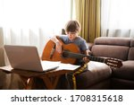 Kid  Boy Playing  Guitar And...