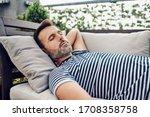 Portrait Of Man Taking Nap On...
