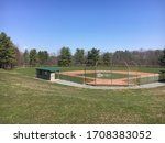 A Baseball Field On A Warm...