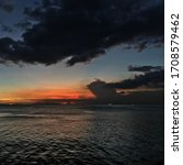 Small photo of Sunset orange skit clouds sea