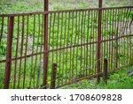 Old Rusty Metal Fence. Abandoned