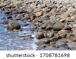 Waves Lapping Smooth Stones Of...