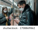 Passengers In Protective Masks...
