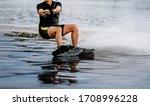 Man Riding Wakeboard On Lake...