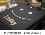 Small photo of Screen print t shirt design. 1 color print using gold shimmer ink on black cotton t shirt.