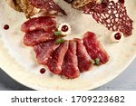 meat appetizer in beige ceramic ...