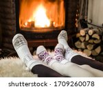 Female Feet In Soft Wool Socks...