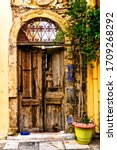 Old Door In Narrow Street Of...