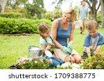 Mother And Children Gardening...