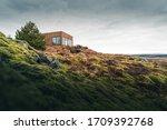 A Tiny House On A Grassy Hill...