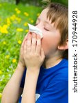 little boy is blowing his nose... | Shutterstock . vector #170944928