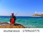 Young Fisherman Sits On The...