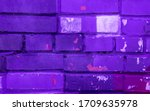 Beautiful bright colorful street art graffiti. Urban grunge bricks background with copyspace on the brick walls of the city.  Blue, neon, violet rough vinrage texture
