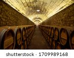 Wine Barrels Stacked In A Cave