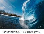 Waves Splashing In Blue Sea On...