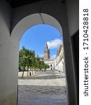 The Giralda Tower in Sevilla, Spain. The tower is embedded in the frame of an arch.