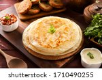 Plain paratha served with sauce