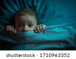 Small photo of child was terrified. the child is afraid of the dark. tormented by nightmares and terrible dreams in children