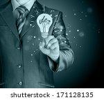 business man touching light of... | Shutterstock . vector #171128135