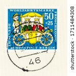Small photo of SEATTLE WASHINGTON - April 20, 2020: German Charity stamp of 1966 featuring carriage, footman, prince and princess, representing the Brothers Grimm fairytale The Princess and the Frog.