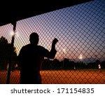 A Silhouette Of A Baseball...