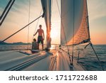 Young Couple Sailing On The...