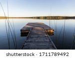 Wooden Jetty In A Calm Lake...