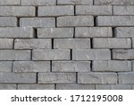 A Stack Of Gray Fluted Bricks...