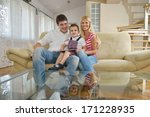 happy young family using tablet ... | Shutterstock . vector #171228935