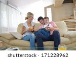 happy young family using tablet ... | Shutterstock . vector #171228962