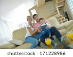 happy young family using tablet ...   Shutterstock . vector #171228986