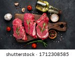 Raw Three Beef Steaks On A...