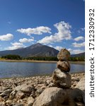 Small photo of Stones piled in a cairn at the edge of Lake Dillon in Colorado. Stacked stones in a meditative environment at the edge of the Dillon Reservoir in Silverthorne, Colorado. Stones and pebbles waterside