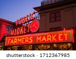SEATTLE, WA - DECEMBER 17, 2016: Iconic, neon, illuminated signs at at Pike Place Market, a world-famous farmers market in Seattle, WA - stock photo