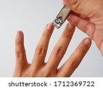 The Left Fingernail Is Cut By A ...