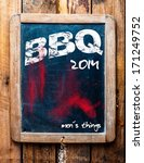 Small photo of BBQ advertised on an old vintage school slate in a grunge wooden frame on a rustic table with an addendum at the bottom saying - Mans stuff