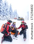 Ski Patrol Team Rescue Woman...